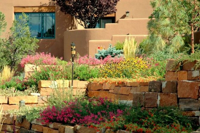 tiki torch, terrace, terraced walls, poolside garden, pool, tumbling flowers, southwestern style garden, stone work, natural stone, rock work, stone walls, masonry walls