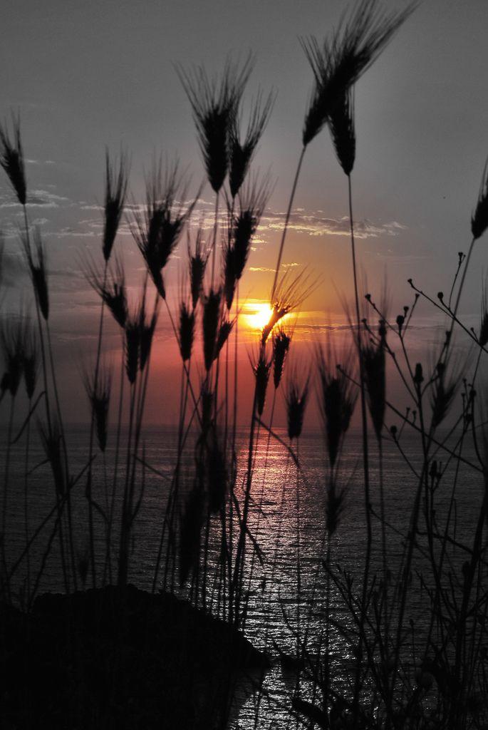 black and orange sun | Ikaria, Greece