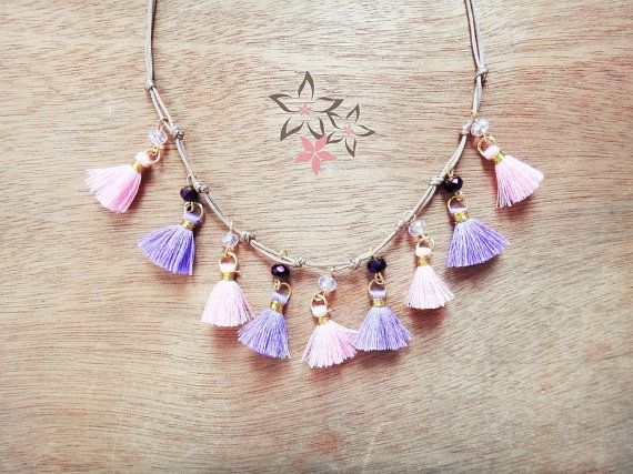 Handmade charm necklace with pink and purple cotton tassels, crystal beads and beige satin cord. Length is adjustable because of the macrame closure.
