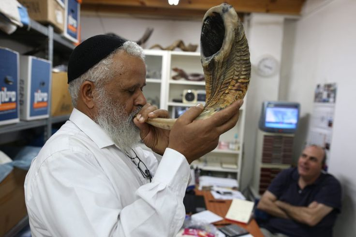 What Is Rosh Hashana? A Look At The Jewish New Year's Meaning And Rituals. 9-21-17 A Jewish man tests the sound of a shofar, a religious musical instrument made from a ram horn, before buying it at a Shofarot factory in Tel Aviv on Sept. 25, 2016, ahead of the Jewish New Year. (Menahem Kahana/AFP/Getty Images)