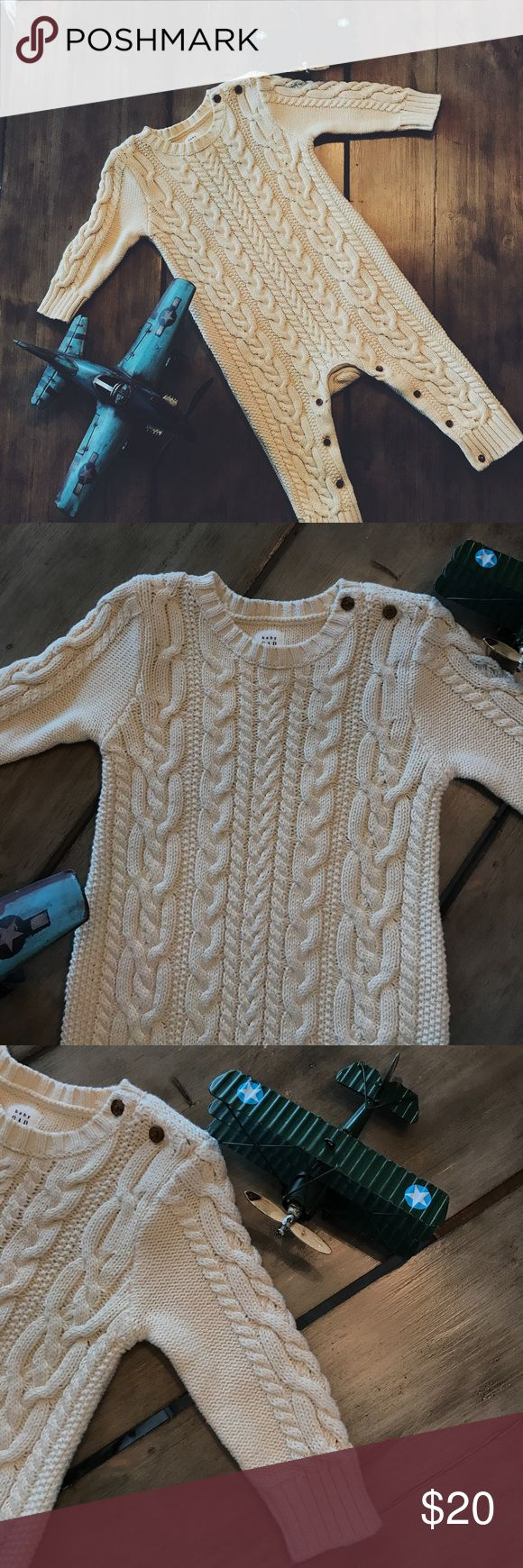 "✈️ Baby Gap 6-12M Cable Knit Sweater One-Piece  Gently used Baby Gap cable knit sweater one-piece-- size 6-12M-- ""french vanilla"" cream color with brown buttons-- snap and button closure-- only worn once for family pictures-- perfect condition  GAP One Pieces"