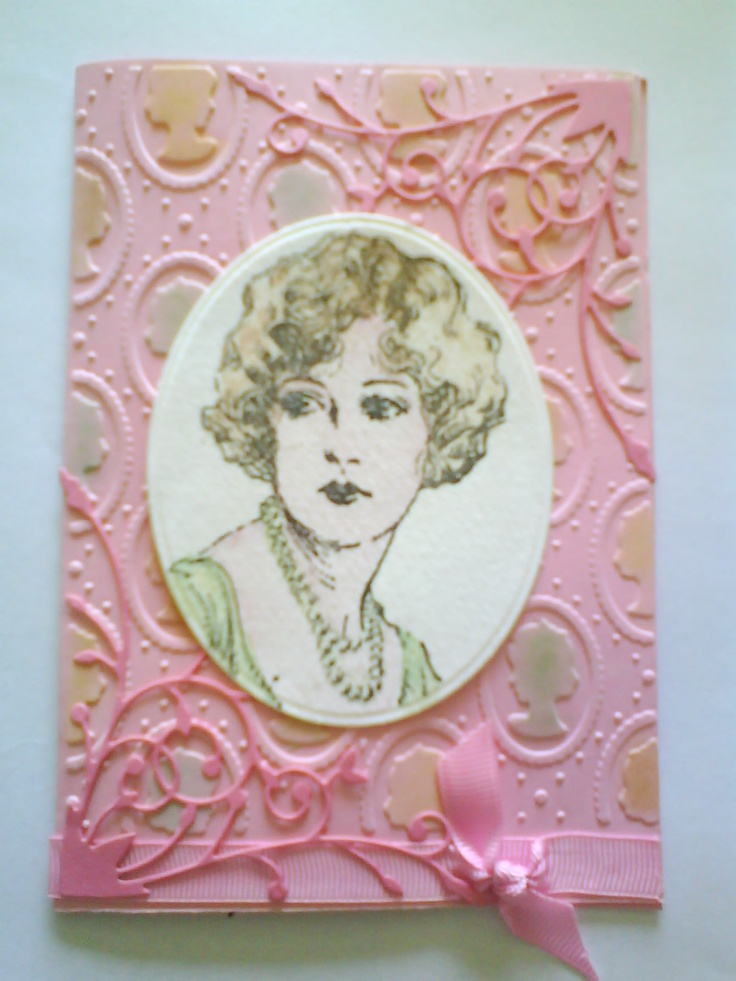 A card using Australian Scrapbooking frre embossing folder, Rubbadubbadoo lady Spell binders nesting cirles, rare memory die Madera corner, chalks and fabercastel pencils and tombo pens
