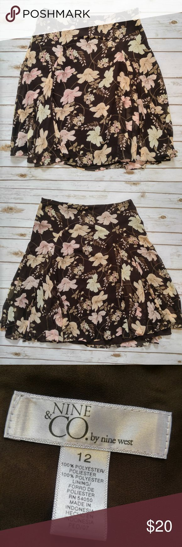 Nine West Brown Floral Chiffon Knee Length Skirt Nine West Brown Floral Knee Length Skirt Size 12 in good used condition. Please feel free to ask any questions or bundle with other listings in my closet for a custom discount on your order. I ship the same day as long as the order is placed before 11:00 AM Central time. If you would like to be notified about price drops remember to 'like' the item to bookmark it! Thank you for checking out my closet and happy poshing! Nine West Skirts Midi