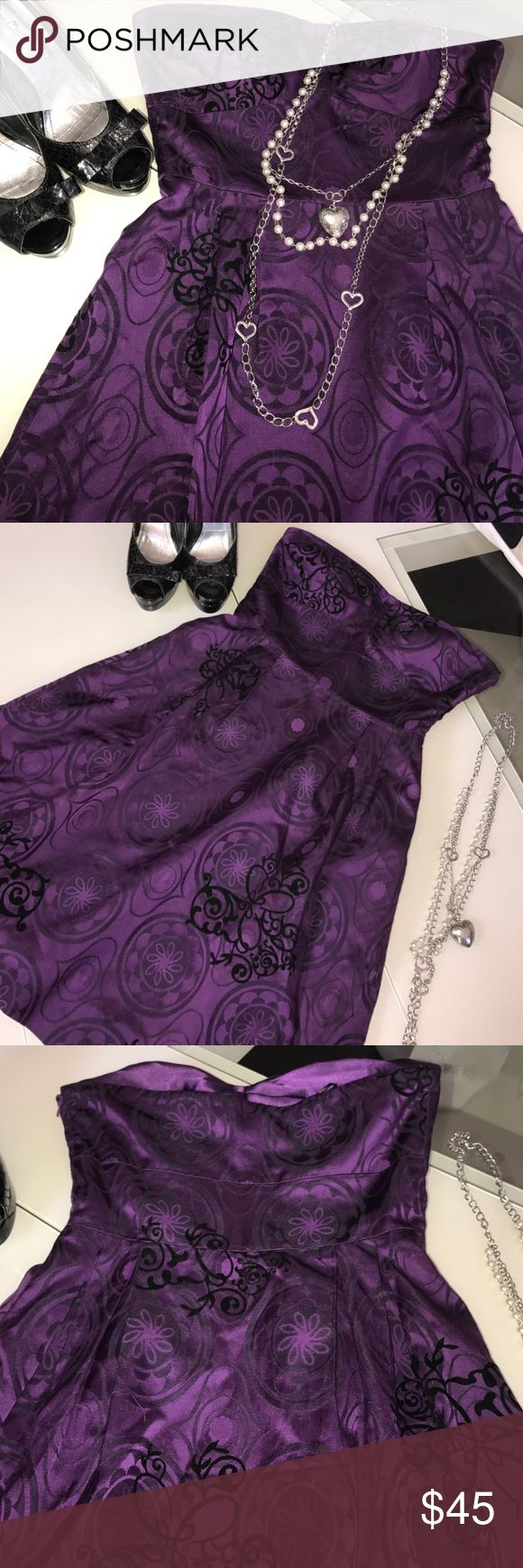Guess dress Guess dress strapless beautiful purple and black color. Size says 5 on dress Guess Dresses Mini