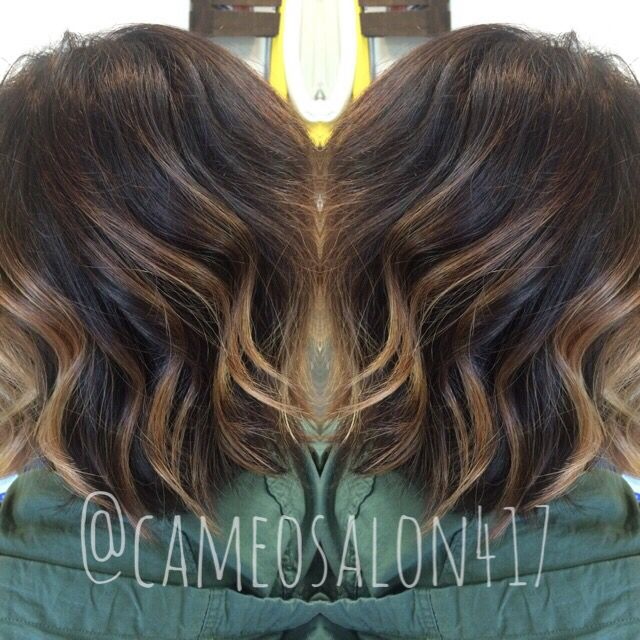 Fall hair. Dark espresso brown base with hand painted highlights. Loose waves on a cute bob.
