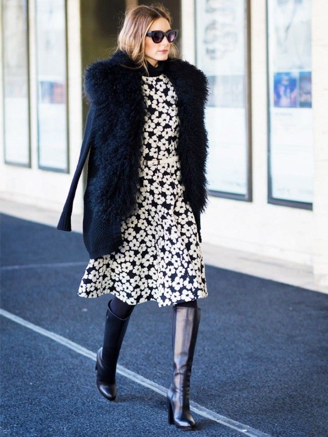 Olivia Palermo wearing a monochrome floral dress, knee high black boots and a fur coat.