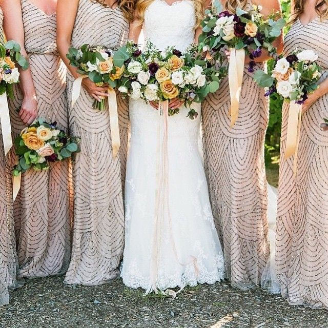 These glitzy neutral bridesmaids dresses complement the bride beautifully