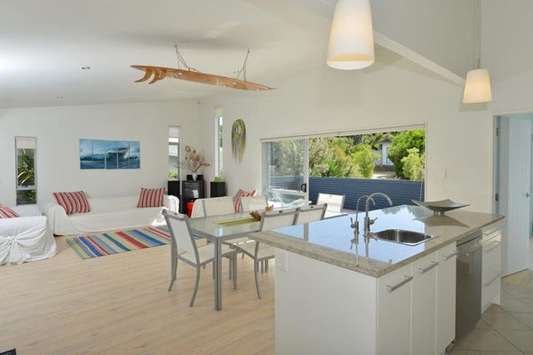 Glen and Marion's sea-inspired steel bach - kitchen with Resene Milk White on the walls.