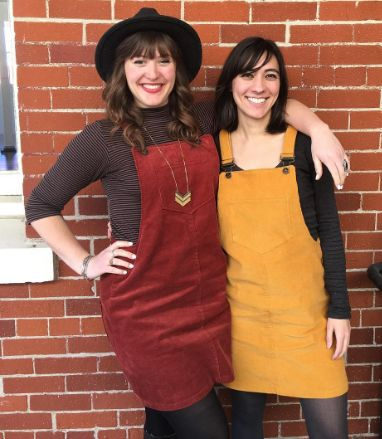 Ella and Anisa in their Cleo dungaree dresses - sewing pattern by Tilly and the Buttons