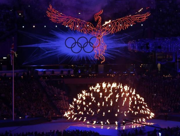 A flaming phoenix flies above the Olympic flame during the closing ceremony of the London 2012 Olympic Games