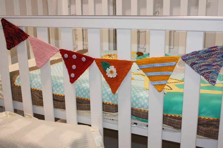 Here is a quick knitted bunting to brighten any child's room. Add a few embellishments to personalise it.