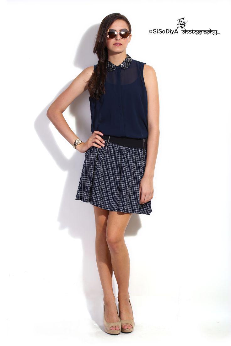 Beautiful girl fashion model in modern clothes posing on podium - series of photos By SISODIYA Photography