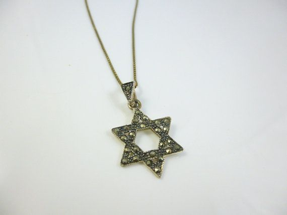 Star of David pendant is made with sterling silver and genuine marcasite stones, back of star is polished silver, the bale has marcasite stones set in. Length of chain - 18 inches  Size of pendant is 1 inch from bale  More Pendants here https://www.etsy.com/shop/perlizjewelcreations?section_id=17185647&ref  More marcasite here https://www.etsy.com/shop/perlizjewelcreations?section_id=17645060&ref  If you would like any further informat...