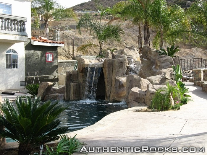 Artificial rock slides for swimming pools