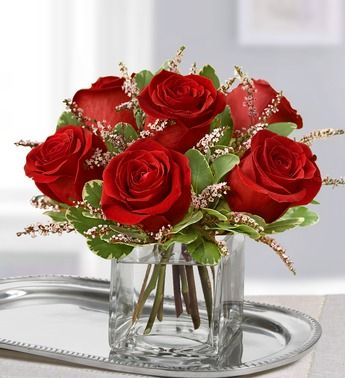 Rose Romance™- Stunning arrangement of red roses, pink calcynia and variegated pittosporum #centerpiece #rosecenterpiece #redroses