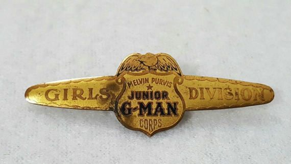 Vintage Melvin Purvis Junior G-Man Corps Girls Division pin. It has a some wear which can be seen in the photos. Measures a little over 2 long.