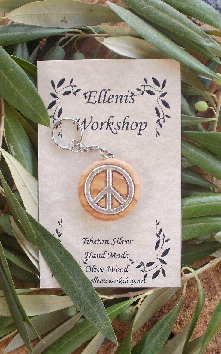 Hand carved Greek Olive Wood key ring inlaid with large Tibetan silver peace symbol, by ellenisworkshop on Etsy