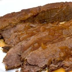 Tender beef brisket is smothered in a tangy and sweet gravy.