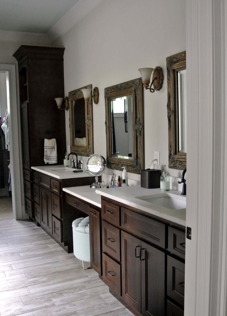 Original Wooden Bathroom Cabinets Feats White Sink And Triple Mirrors On White Wall Plus Laminate Floor Idea