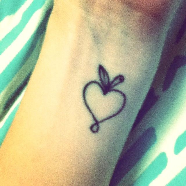 Outline Heart Apple Tattoo Design On Left Wrist