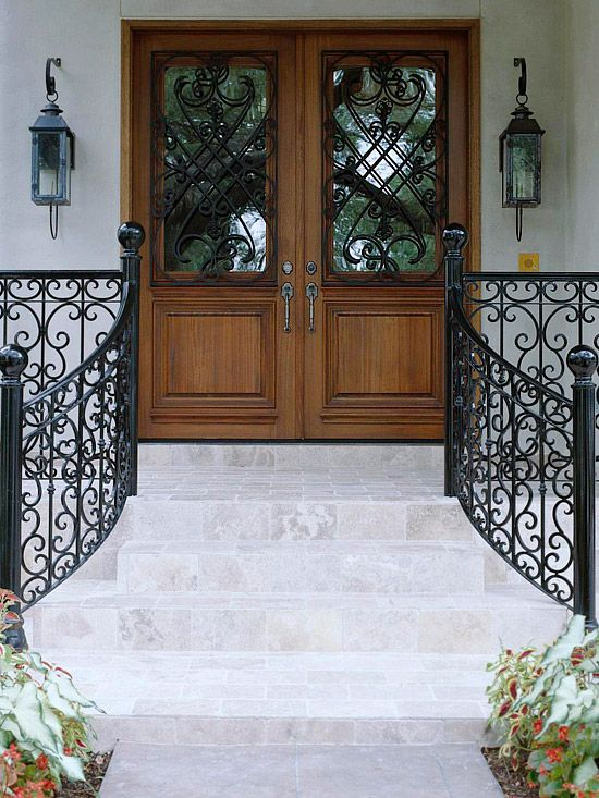 Home Entrance With Beautifully Detailed Wrought Iron Features