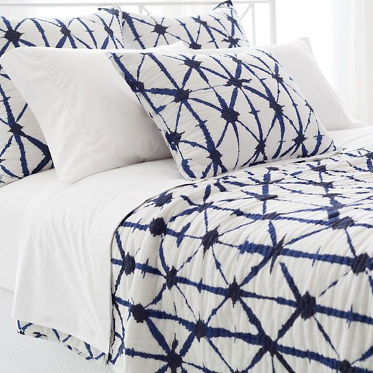A vivid blue graphic bursts across a crisp white background on this classic cotton quilt. Layer with our marine, sky, ink, indigo, and French blue coordinates, or contrast with any of our colorful  matelassé coverlets and shams.   • 100% cotton.  • Straight edge.