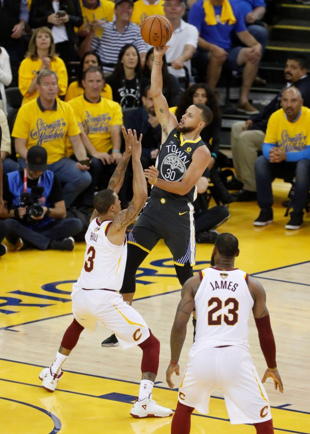 Golden State Warriors Stephen Curry 30 Takes A Shot Against Cleveland Cavaliers George Hill 3 In The Fourth Quarter Nba Finals Warriors Stephen Curry Nba