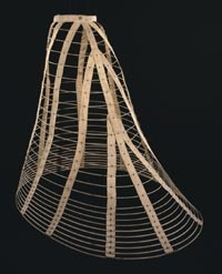 """Hoop Skirt: Bradley's """"Patent Duplex Elliptic Spring Skirt""""  Made in New York, United States    c. 1867-68  Made by Wests' Bradley & Cary, New York  Cotton-covered spring steel hoops; cotton tapes; copper alloy buckle, fasteners, and patent grommet  Circumference: 109 inches (276.9 cm) Diameter: 35 inches (88.9 cm)"""