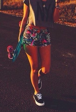 The crop top and the floral shorts is adorable and then you have the toms and the skateboard is so fabulous.