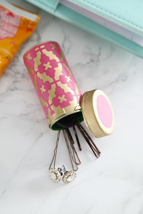 Decorate an old pill bottle to carry Bobby pins and jewelry in your purse!