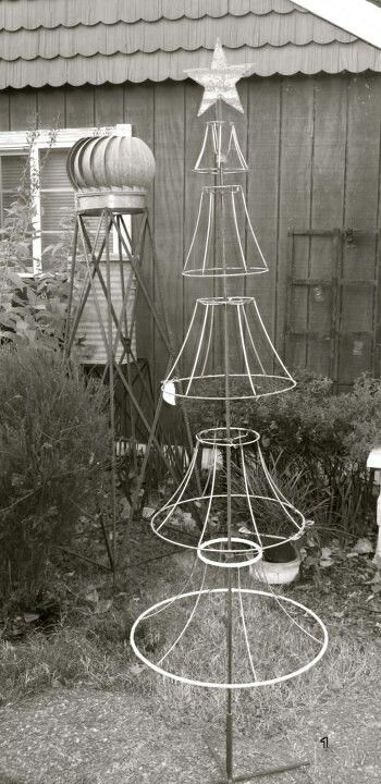 Fun and easy project with old lamp shades, the key is to find the right size that will form a tree.