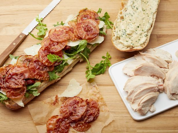 Recipe of the Day: Caesar Club Sandwich         Ina's elegant sandwich comes stacked with chicken, crispy pancetta, shaved Parmesan and sundried tomatoes, all between toasted ciabatta bread slathered in her garlicky dressing.