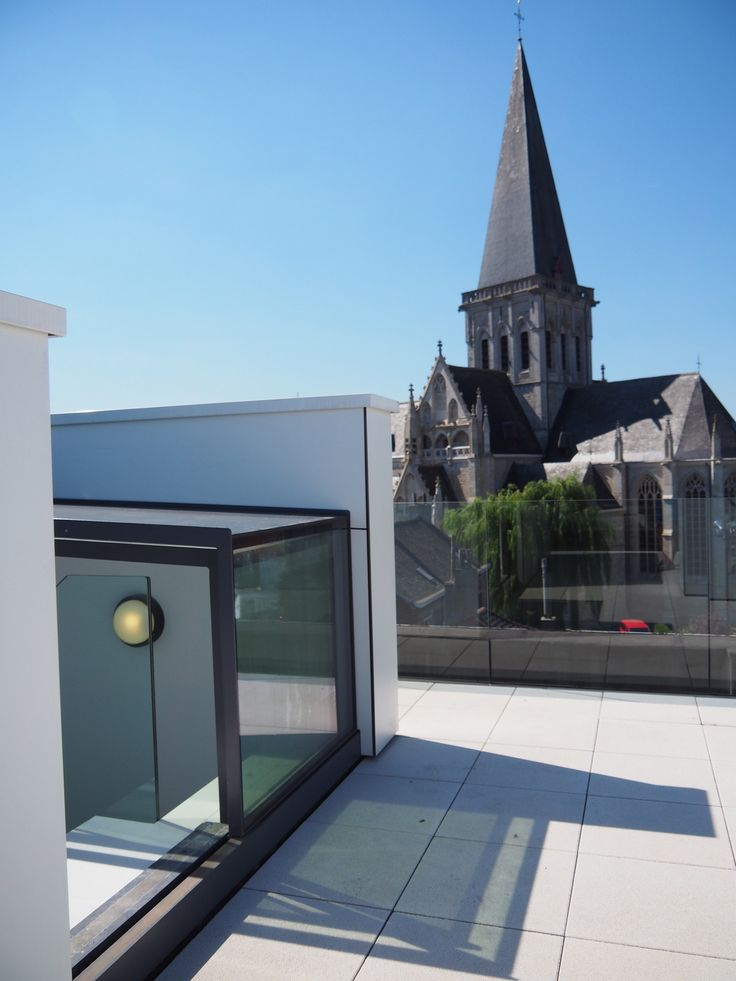 Roof top terrace with nice view on 17th century St Pieters Church. Three wall box provides elegant entrance.