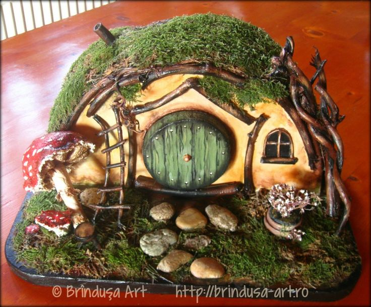 Hobbit home, painted in acrylics: out of wood, fabric, dried up grass/moss…