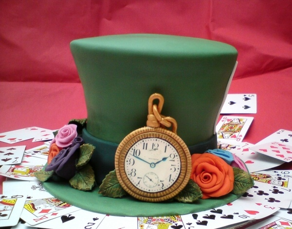 Personal Mad Hatter hat cake. plus some fabulous cupcakes