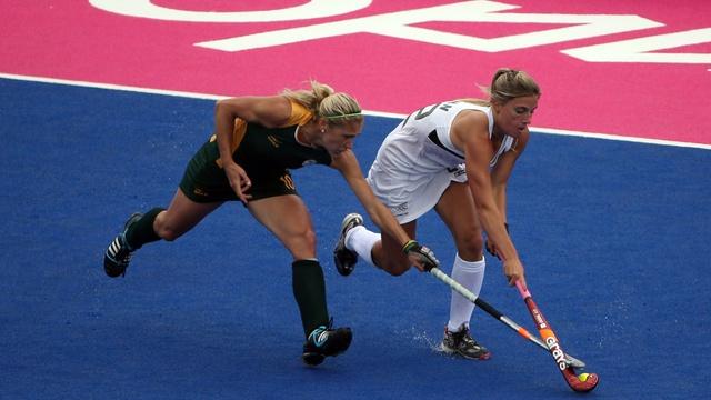Shelley Russel of South Africa (L) & Gemma Flynn of New Zealand - Women's Field Hockey - 2012 Olympics - via Jezebel
