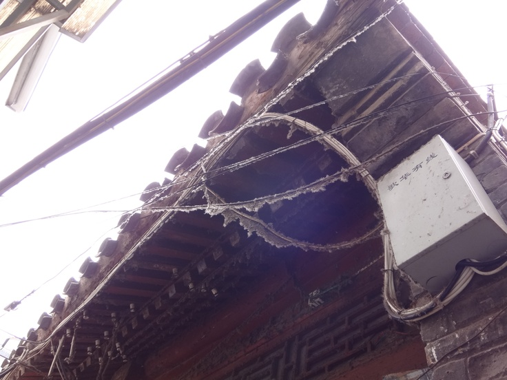 dust curtains hanging on the wires@ Hutong