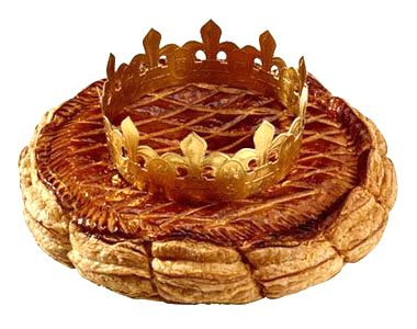"""galette des rois: (King's Cake) for La Fête des Rois/Epiphany. Celebrated 12 days after Christmas, friends and family get together in a tradition that involves this simple cake. Whoever discovers the hidden """"feve"""" inside the cake becomes King or Queen for the day."""
