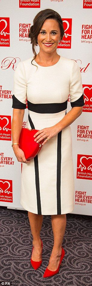 Pippa paired the black and white evening dress with a heart-shaped bag and matching red hi...