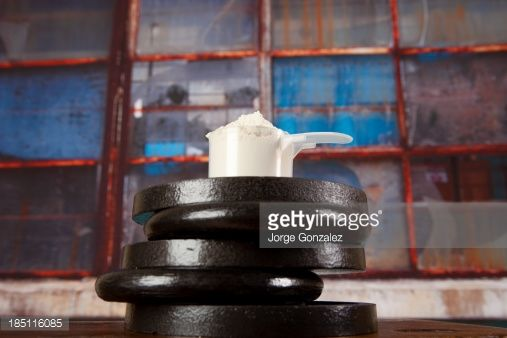Stock Photo : Barbell weights and protein powder
