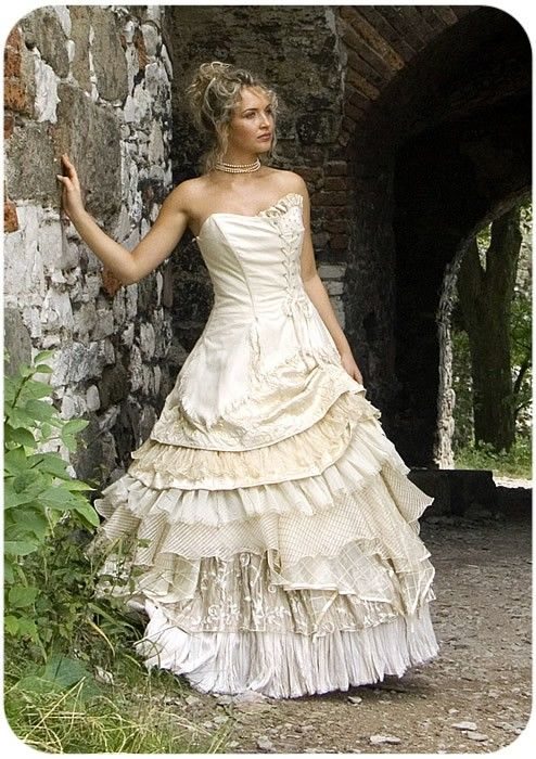 What a beautiful wedding dress. Love the many layered and textured skirt, white on white just looks so cool.