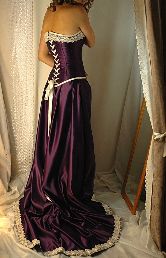 Purple Corset Dress $685.00 I LOVE this, but not so sure I would look good in it.