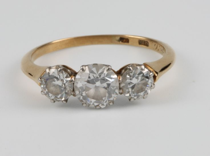 Lot 675, An 18ct yellow gold 3 stone diamond ring, the centre brilliant cut stone approx 0.7ct flanked by a by a brilliant cut stone approx 0.33ct each, size M, sold for £1,100
