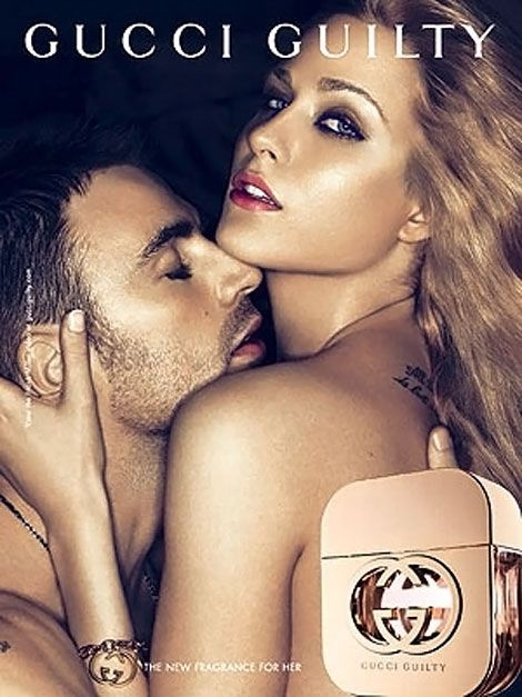 This perfume advert has the models in the centre an the bottle is placed in front of them. The name of the brand and perfume is written along the top, clearly seen by viewers.
