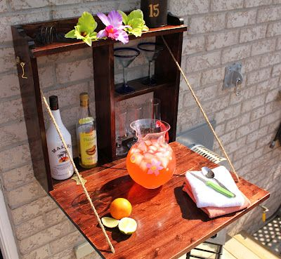 Compact Bar Space... Love this!  Even if you're not doing the bar idea, you can still have a refreshment station up high, off the table (and out of reach of small hands)!