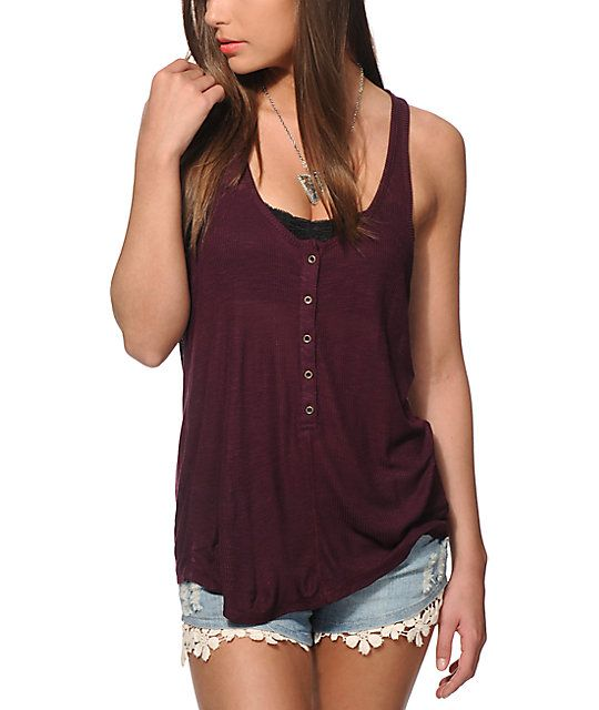 Take your style back to the basics with this blackberry ribbed henley tank top that features a 5 button front placket and a loose draped fit.