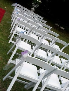White Americana Folding Chairs with silk butterflies @ Chateau Yering