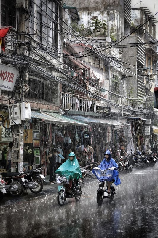 Sudden downpour on 'Old Quarter' Hanoi, Vietnam