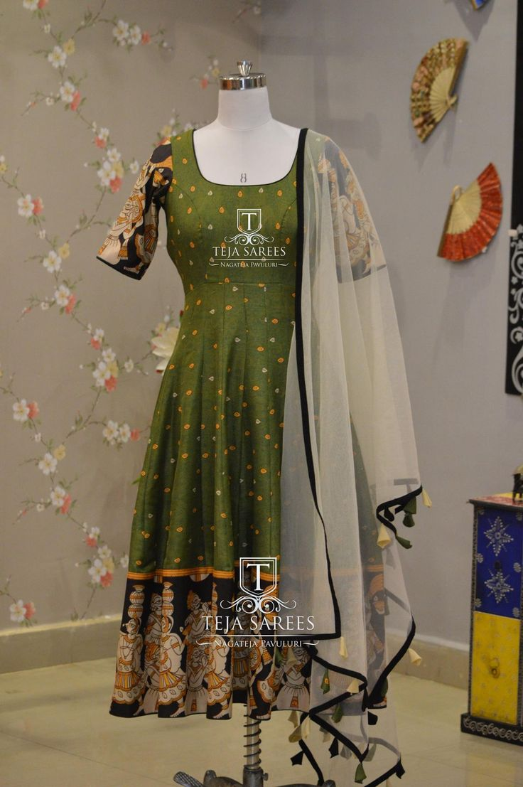 TS-DS- 505. Beautiful bottle green color anarkali dress with kalamkari boarder and white net dupatta.Available For orders/queriesCall/ whats app on8341382382 orMail tejasarees@yahoo.com. 03 October 2017
