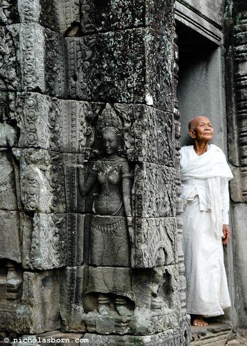 Buddhist nun - Angkor Wat, Cambodia - Nicholas Born photography - http://www.nicholasborn.com/post/18009308198/angkor-wat-cambodia